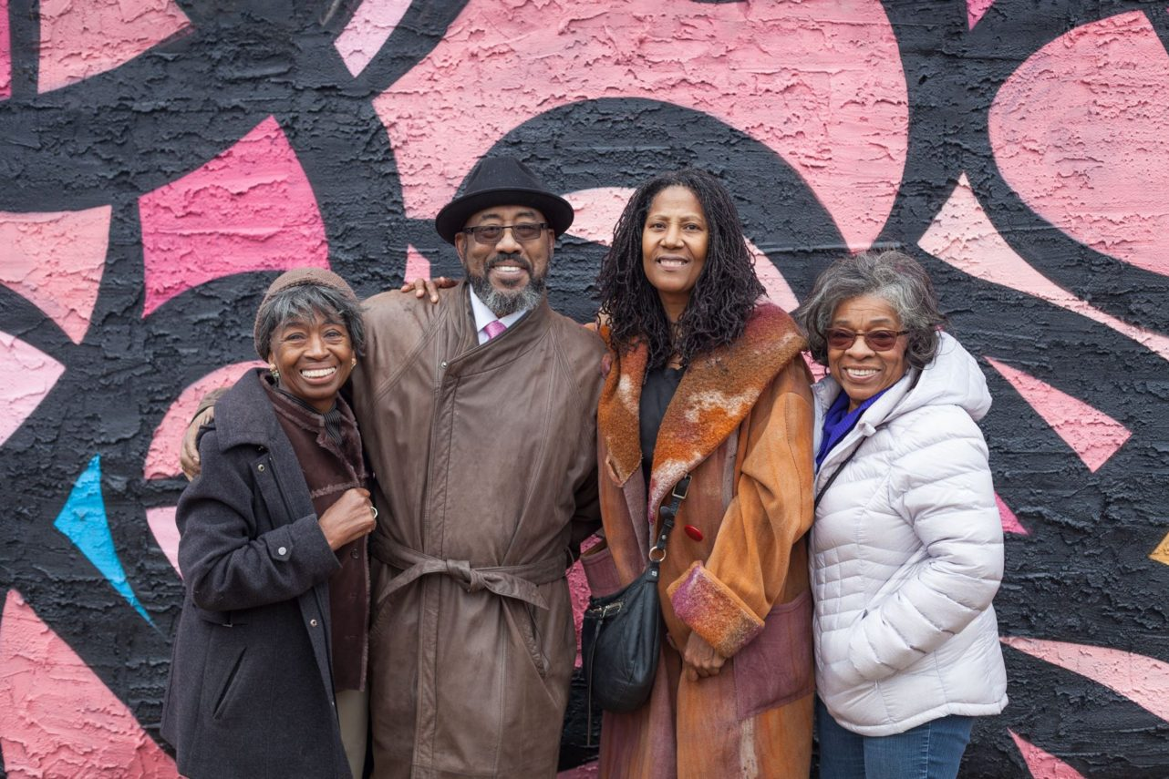 "West Powelton residents -- Ardie, Kernard, Pam, and Patricia -- at the opening dedication of ""Soul of the Black Bottom"" mural by eL Seed. Photo by Chip Colson."