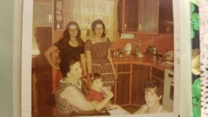 Standing: Left to right: Patrizia's cousin Marinella Cipollone, Mom, Venia D'Adamo Seated: Grandmother, Mariannina Sonsini holding Patrizia D'Adamo Right bottom: Brother Marco D'Adamo