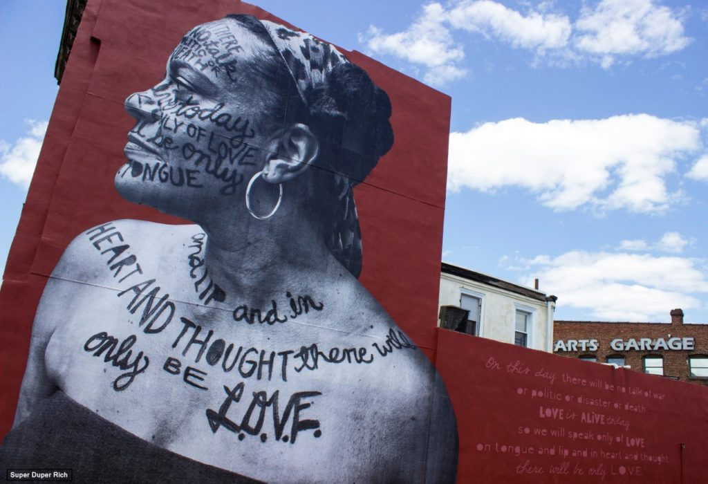 "Mural of Ursula Rucker and ""L.O.V.E."" poem. Photo courtesy of the artist."