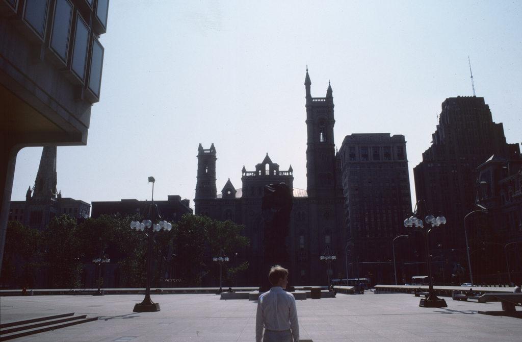 The man in white strolling through Thomas Paine Plaza.